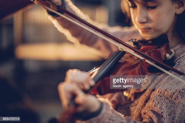 girl playing violin - music style stock pictures, royalty-free photos & images