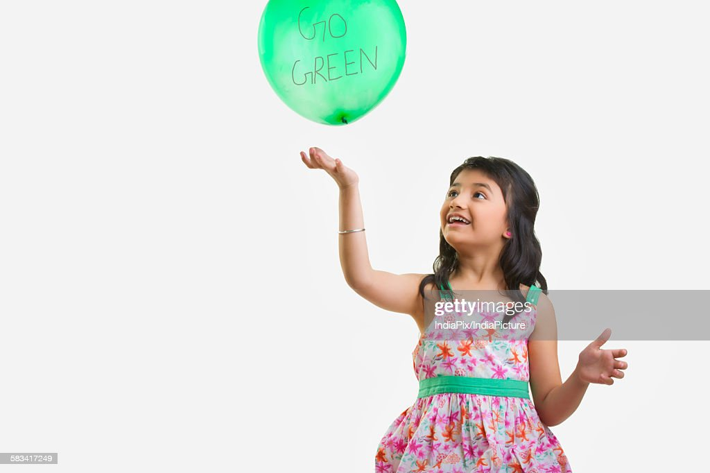 Girl playing with a balloon : Stock Photo
