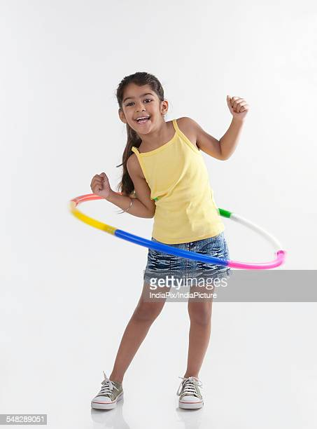 Girl playing with a hoola hoop
