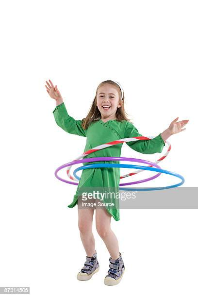 A girl playing with a plastic hoop