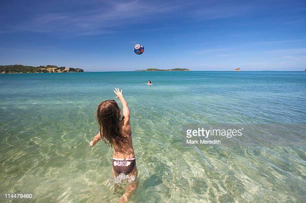 Girl playing  with beach ball