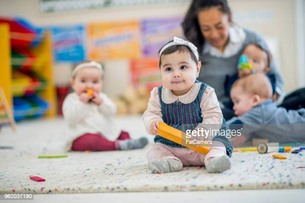 girl playing with block - child care stock pictures, royalty-free photos & images