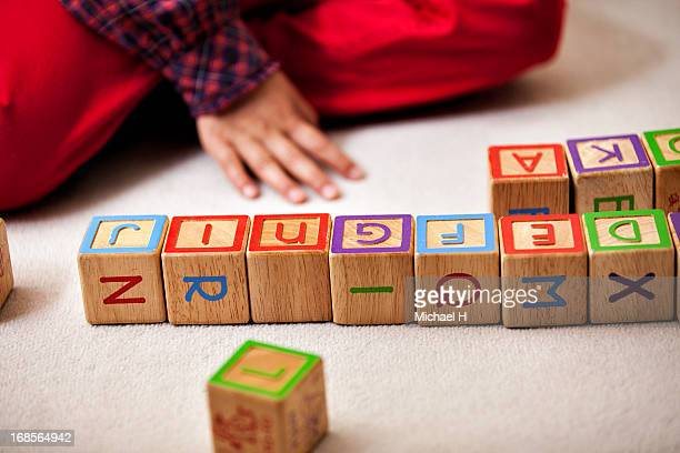 Girl playing with blocks on the floor