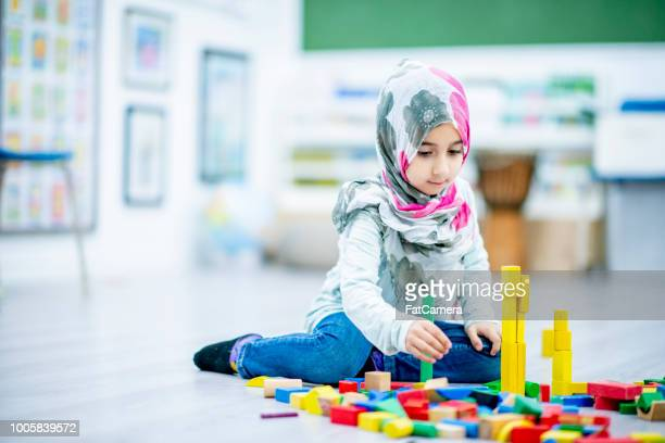 Girl Playing With Blocks