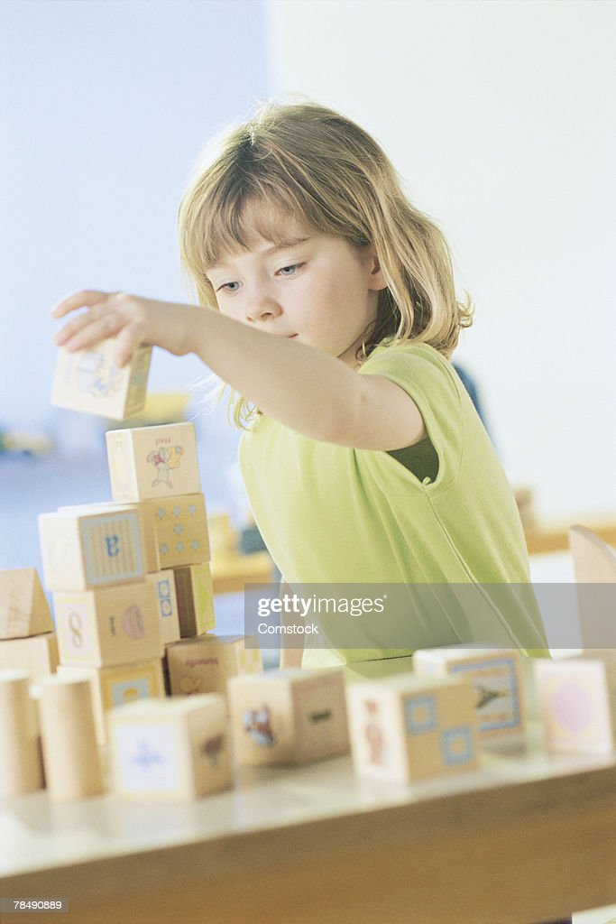 Girl playing with blocks : Stock Photo