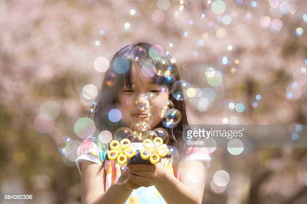 Girl playing with bubbles, Chiba Prefecture, Honshu, Japan