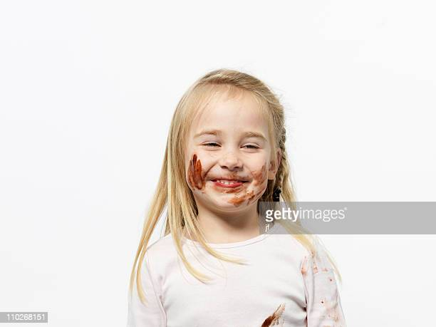 Girl playing with chocolate sauce