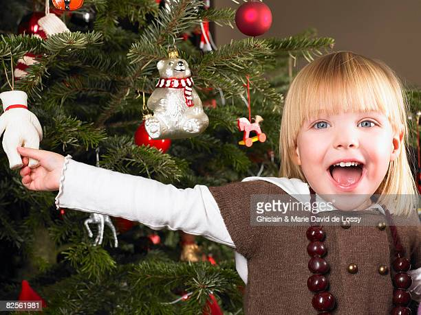 girl playing with christmas decoration - santa face stockfoto's en -beelden