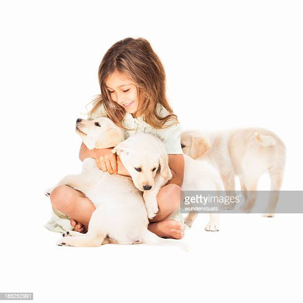 girl playing with dogs - three animals stock pictures, royalty-free photos & images