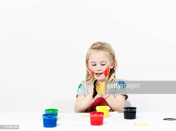 Girl playing with finger paint