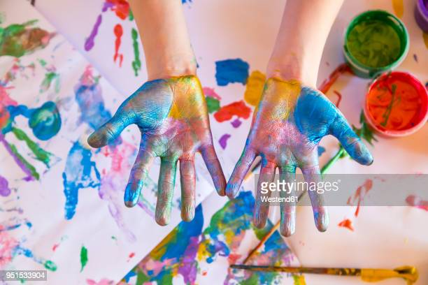 girl playing with finger paint - track imprint stock photos and pictures