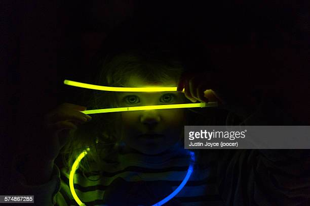 Girl playing with glowing sticks