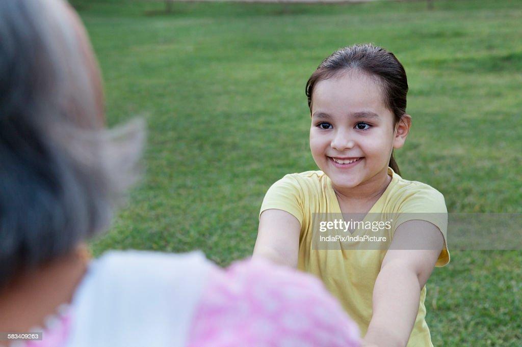 Girl playing with grandmother : Stock Photo