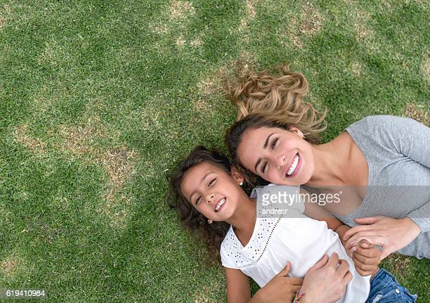 Girl playing with her mother at the park