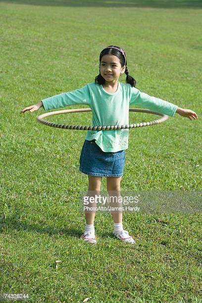 Girl playing with hoola hoop