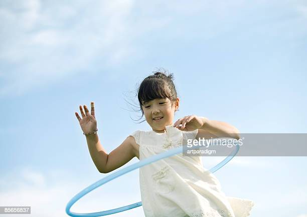 Girl playing with Hula-Hoop