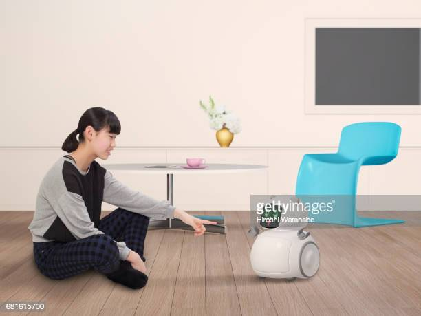 Girl playing with Personal Robot in  the living room