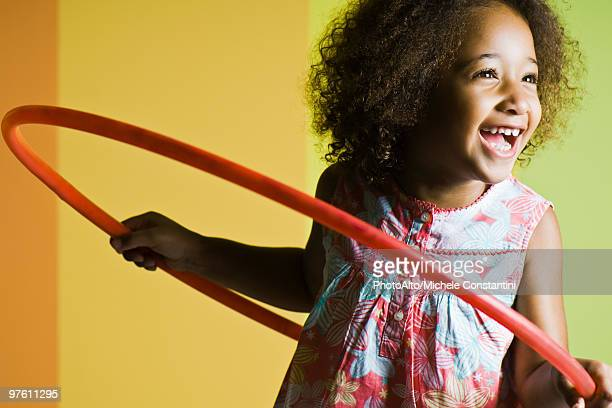 girl playing with plastic hoop - three quarter front view stock pictures, royalty-free photos & images