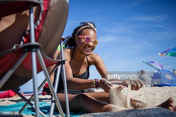 girl playing with sand on beach, truro, massachusetts, cape cod, usa - heshphoto stock pictures, royalty-free photos & images
