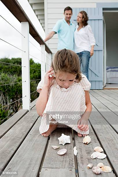 Girl playing with seashells
