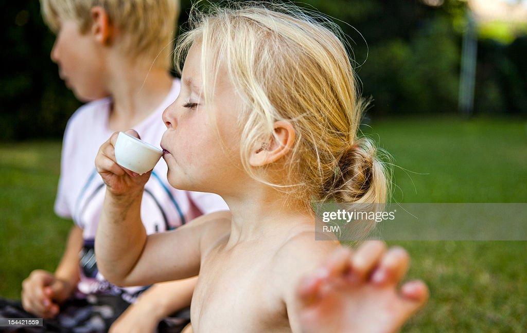Girl Playing with Tea Set : Stock-Foto