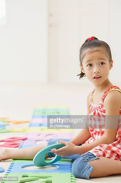 Girl playing with toy alphabet letters