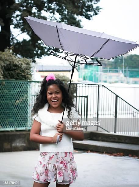 girl playing with umbrella upside down - mamigibbs stock photos and pictures