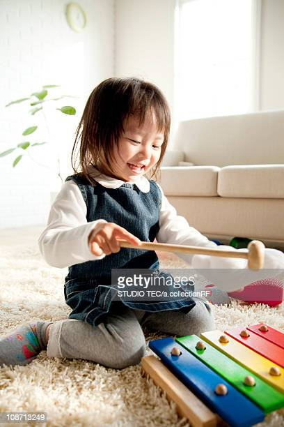 Girl playing with xylophone