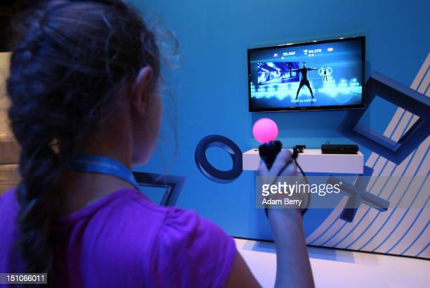 A girl plays a dancing game on a Playstation 3 video console during the Internationale Funkausstellung 2012 consumer electronics trade fair on August...