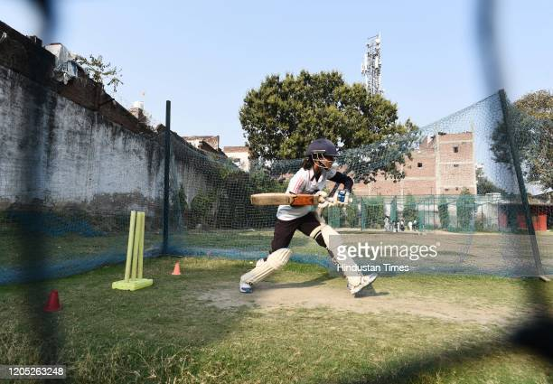 Girl plays a shot during a practice session at a cricket academy, on February 29, 2020 in Agra, India. Agra has produced so many women cricketers...