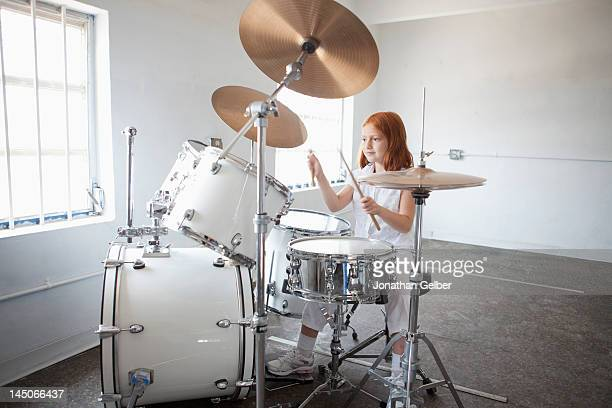 Girl plays drum kit