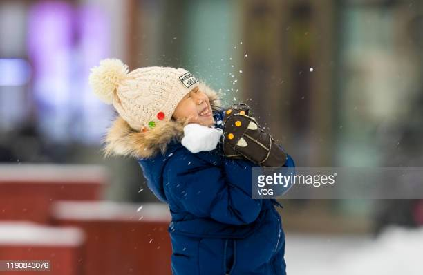 A girl plays in snow on November 29 2019 in Hohhot Inner Mongolia Autonomous Region of China Snow hit parts of China on Friday