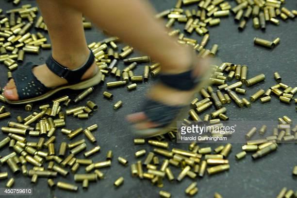 A girl plays in the artwork 20000 Gun Shells by Matias Faldbakken in the Unlimited section of Art Basel on June 17 2014 in Basel Switzerland Art...