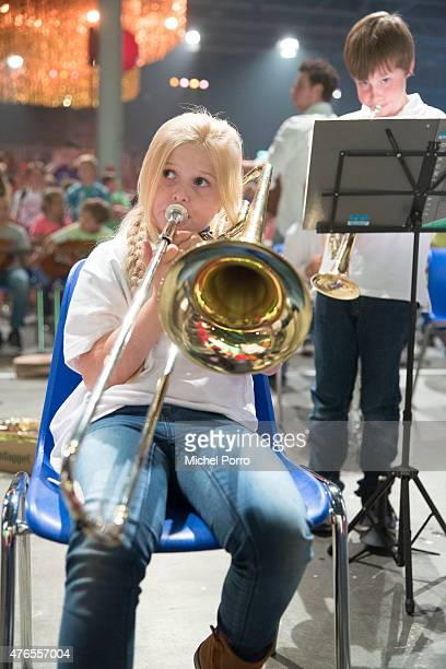 A girl plays the trombone in the concert Children Make Music on June 10 2015 in Utrecht Netherlands The aim of the initiative is to facilitate as...