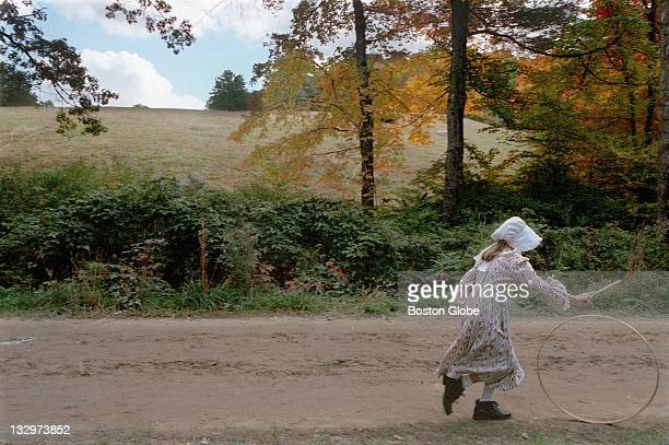 A girl plays with a hoop at Old Sturbridge Village in Sturbridge Mass