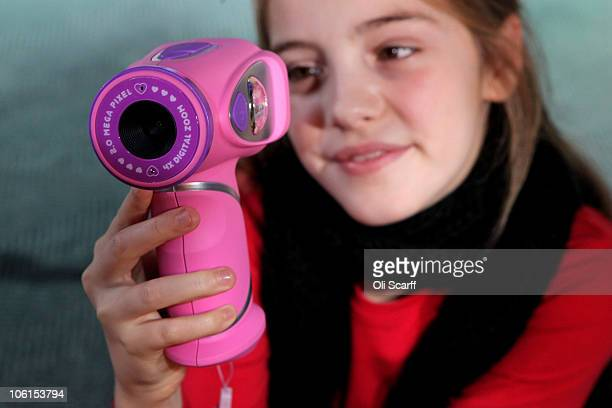 A girl plays with a 'Kidizoom VideoCam' at the Toy Retailers Association's annual 'Dream Toys' fair on October 27 2010 in London England The Toy...