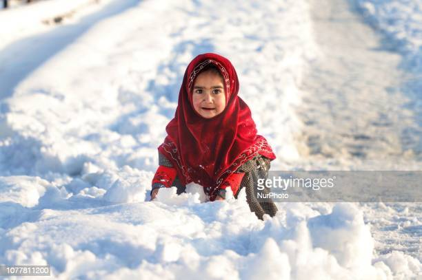 A girl plays with snow in Sopore town of District Baramulla Some 55 Kms from Srinagar India on 5th January 2019