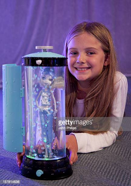A Girl Plays With The Monster High Lagoona'S Hydration Station By Mattel At The Toy Retailers Association'S Annual 'Dream Toys' Fair On October 26...