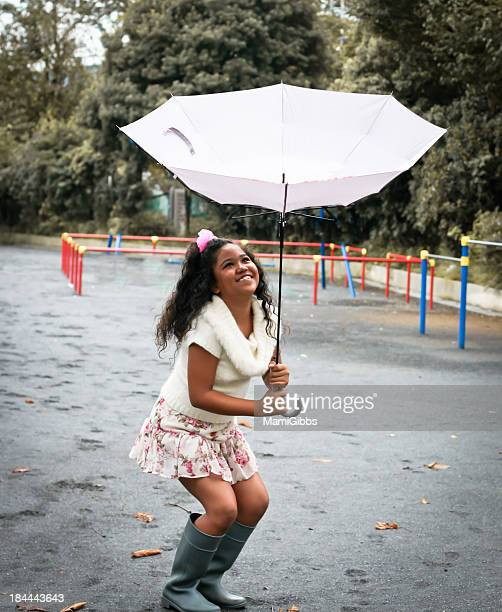 girl plying inside out of umbrella - inside out stock pictures, royalty-free photos & images