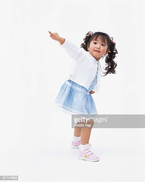 A girl pointing at a direction