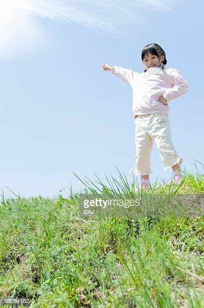 A Girl Pointing the Sky