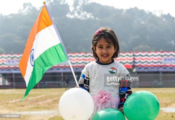 A girl pose for photograph holding an Indian Flag during 71st Republic Day celebrations at Veterinary College Playground Khanapara in Guwahati Assam...