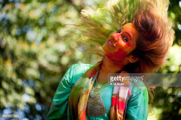 UNIVERCITY DHAKA BANGLADESH A girl poses for picture when she attends to celebrate the Holi Festival or Festival of Colors after smearing each other...