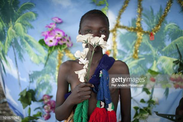 A girl poses for pictures in a photo studio before at a traditional Reed dance ceremony at the stadium at the Royal Palace on August 29 in Ludzidzini...