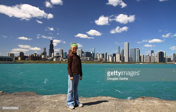 Girl poses in front of the Chicago city skyline