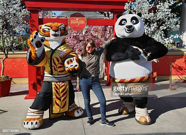 Girl poses with Tigress and Po from the 'Kung Fu Panda' film series at Universal Studios Hollywood on January 25 2017 in Universal City California