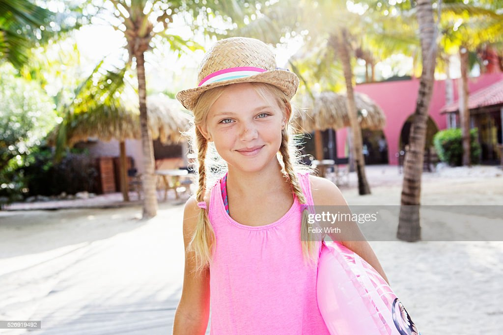Girl (10-12) posing on beach : Stock-Foto