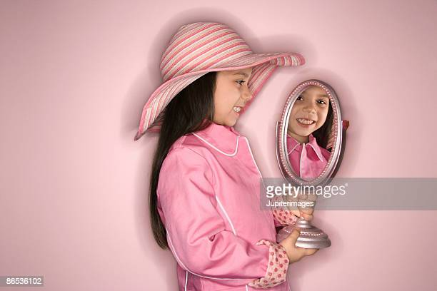 girl posing with mirror - pink hat stock pictures, royalty-free photos & images