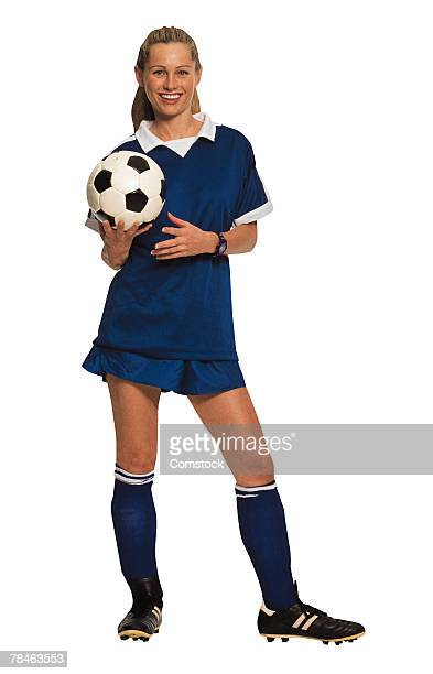 girl posing with soccer ball - fußballtrikot stock-fotos und bilder