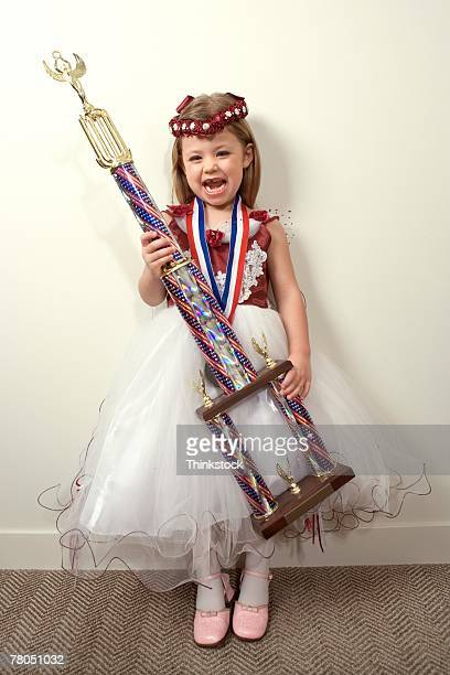 Girl posing with trophy